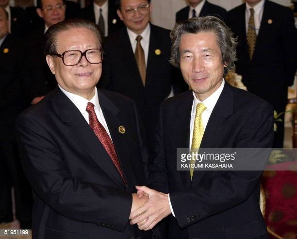 Chinese President Jiang Zemin shakes hands with Japanese Prime Minister Junichiro Koizumi before their bilateral meeting after the AsiaPacific...
