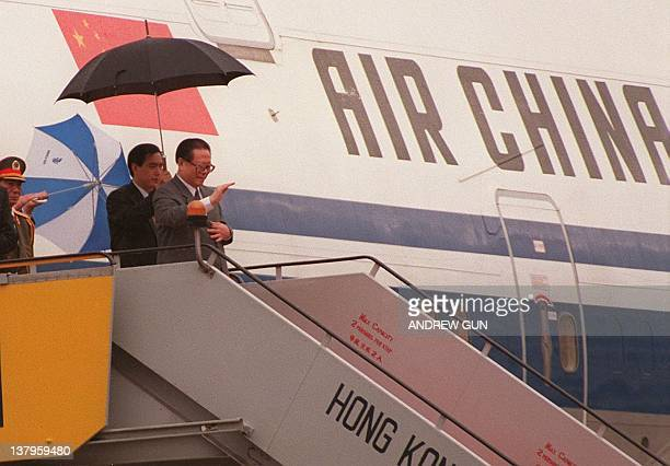 Chinese President Jiang Zemin walks down the steps at Hong Kong's Kai Tak airport 30 June to attend the territory's handover to Chinese rule Jiang is...