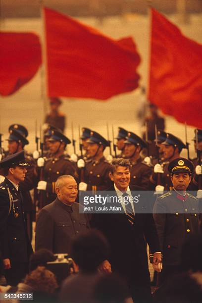 Chinese president Li Xiannian welcomes American president Ronald Reagan with a military parade in his honor