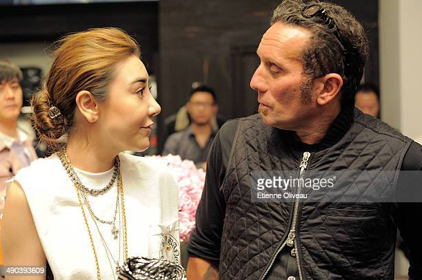 Chinese president of Yintai Tiffany Zhang and owner and designer of Chrome Hearts Richard Stark hold a conversation during the Chrome Hearts Beijing...