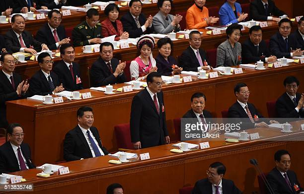 Chinese President Premier Li Keqiang is applauded after delivering his work report as Chinese leaders Yu Zhengsheng President Xi Jinping Liu Yunshan...