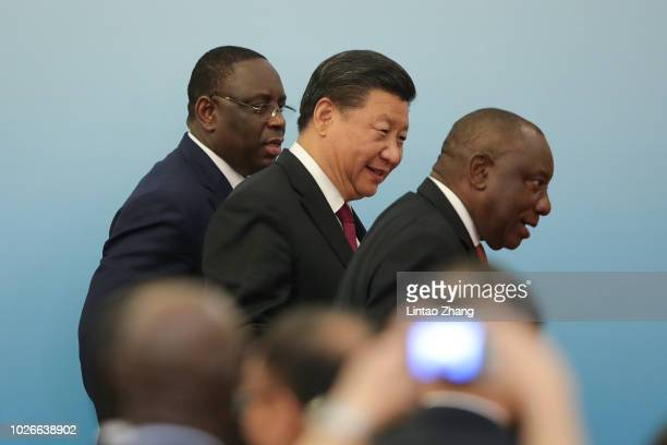 Chinese President Xi Jingping with South African President Cyril Ramaphosa and Senegalese President Macky Sall attend the 2018 Beijing Summit Of The...