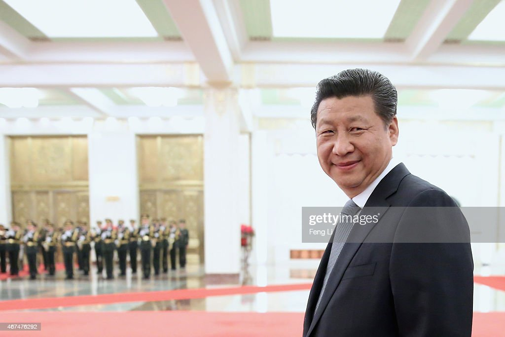 Chinese President Xi Jinping accompanies Armenian President Serzh Sargsyan to view an honour guard during a welcoming ceremony inside the Great Hall of the People on March 25, 2015 in Beijing, China.
