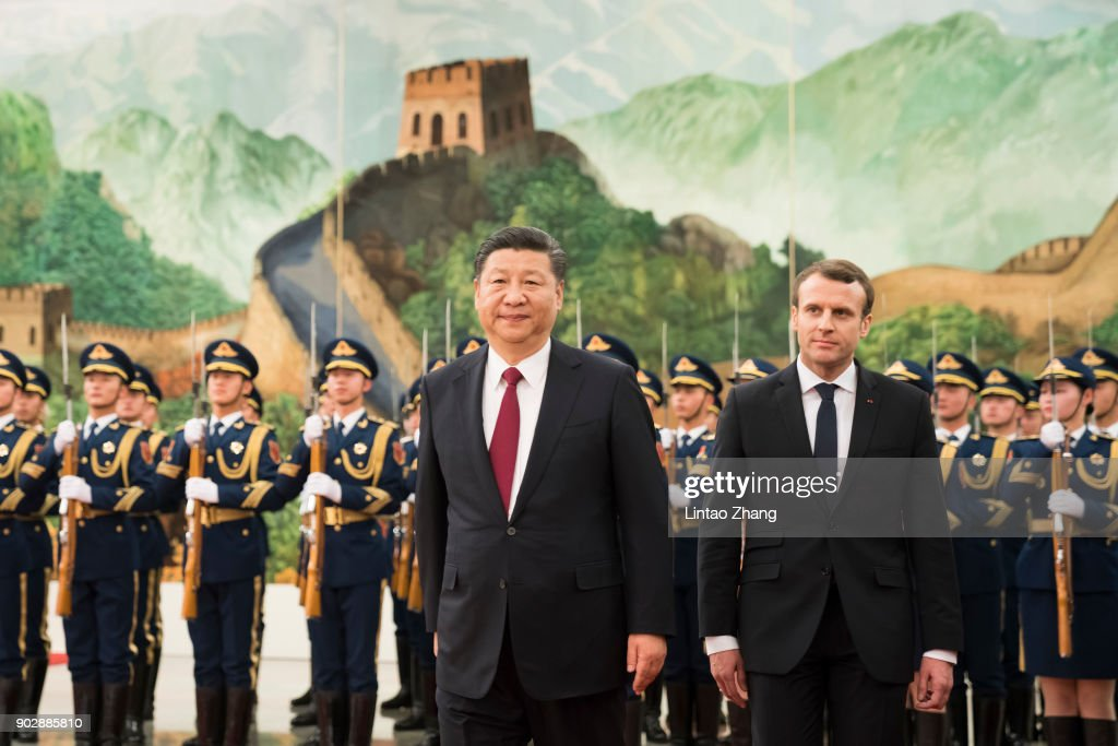 Chinese President Xi Jinping accompanies French President Emmanuel Macron to view an honour guard during a welcoming ceremony inside the Great Hall of the People on January 9, 2018 in Beijing, China. At the invitation of Chinese President Xi Jinping, President of the French Republic Emmanuel Macron will pay a state visit to China from January 8th to 10th.