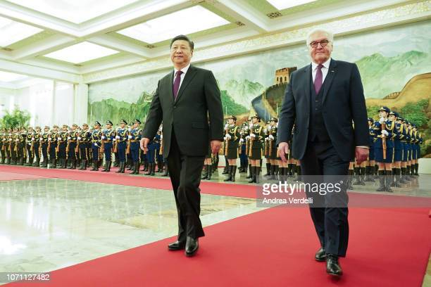 Chinese President Xi Jinping accompanies German President FrankWalter Steinmeier as they review the guard of honour of the People's Liberation Army...