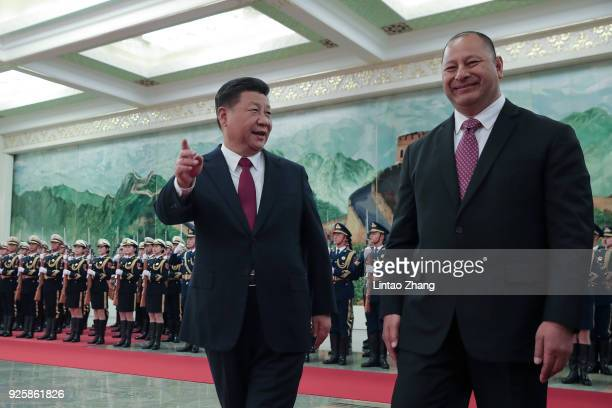 Chinese President Xi Jinping accompanies King Tupou VI to view an honour guard during a welcoming ceremony inside the Great Hall of the People on...