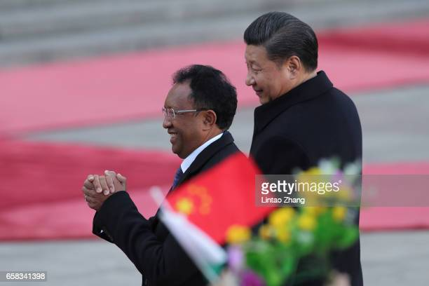 Chinese President Xi Jinping accompanies Madagascar President Hery Rajaonarimampianina to view a guard of honour during a welcoming ceremony outside...
