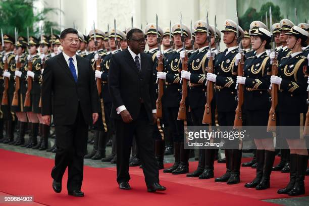 Chinese President Xi Jinping accompanies Namibia's President Hage G. Geingob to view an honour guard during a welcoming ceremony inside the Great...