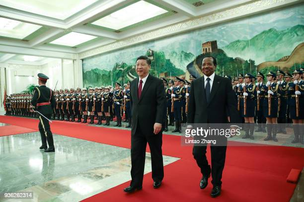 Chinese President Xi Jinping accompanies President of Cameroon Paul Biya to view an honour guard during a welcoming ceremony inside the Great Hall of...