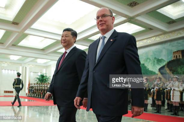 Chinese President Xi Jinping accompanies Prince Albert II of Monaco to view an honour guard during a welcoming ceremony inside the Great Hall of the...