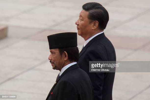 Chinese President Xi Jinping accompanies Sultan of Brunei Hassanal Bolkiah during a welcoming ceremony outside the Great Hall of the People on...