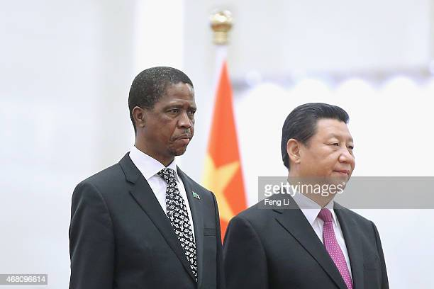Chinese President Xi Jinping accompanies Zambia's President Edgar Chagwa Lungu to view an honour guard during a welcoming ceremony inside the Great...