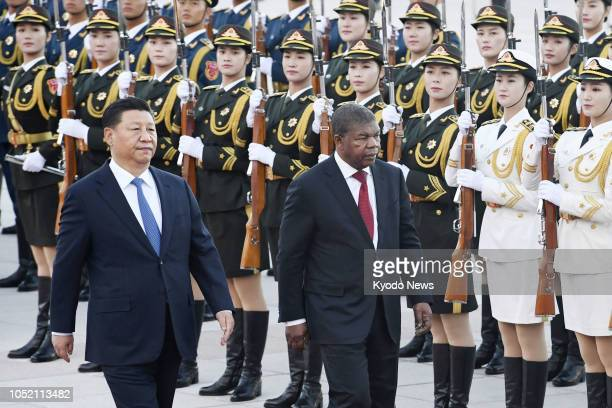 Chinese President Xi Jinping and Angolan President Joao Lourenco attend a welcome ceremony at the Great Hall of the People in Beijing on Oct 9 2018...