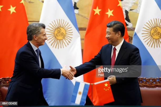 Chinese President Xi Jinping and Argentina's President Mauricio Macri attend a signing ceremony at the Great Hall of the People on May 17, 2017 in...
