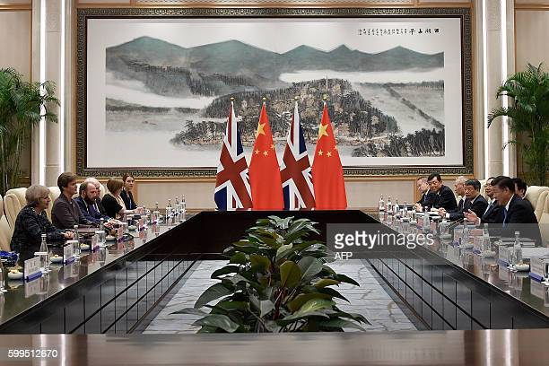 Chinese President Xi Jinping and British Prime Minister Theresa May take part in a bilateral meeting with their delegations at the West Lake State...