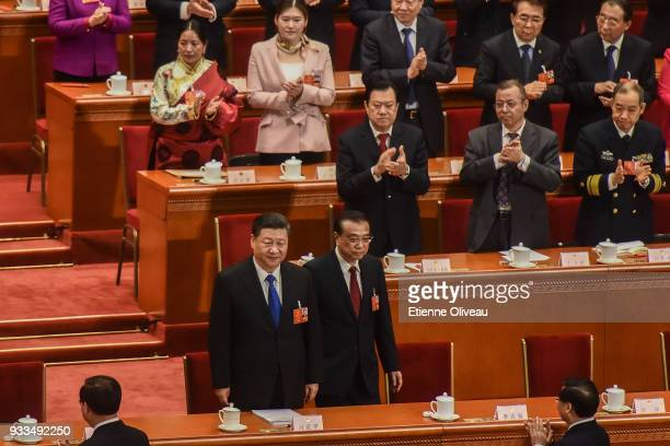 Chinese President Xi Jinping and Chinese Premier Li Keqiang arrive to attend the sixth plenary session of the National People's Congress at the Great...