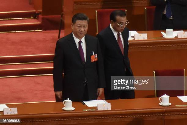 Chinese President Xi Jinping and Chinese Premier Li Keqiang attend the 5th plenary session of the first session of the 13th National People's...