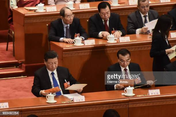 Chinese President Xi Jinping and Chinese Premier Li Keqiang examine they ballot during the sixth plenary session of the National People's Congress at...