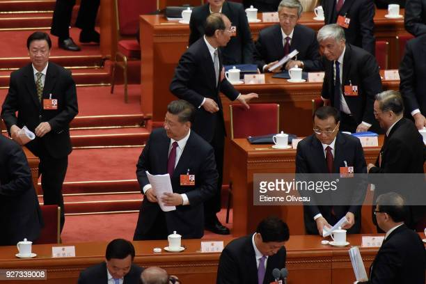 Chinese President Xi Jinping and Chinese Premier Li Keqiang leave The Great Hall of People after the opening session of the 13th National People's...