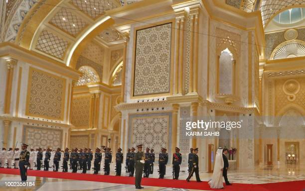 Chinese President Xi Jinping and Crown Prince of Abu Dhabi Sheikh Mohamed bin Zayed Al Nahyan review the honorary guards at the presidential palace...