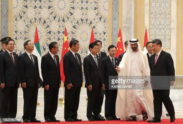 Chinese President Xi Jinping and Crown Prince of Abu Dhabi Sheikh Mohamed bin Zayed Al Nahyan greet a group of Chinese minsiters accompanying the...