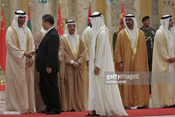 Chinese President Xi Jinping and Crown Prince of Abu Dhabi Sheikh Mohamed bin Zayed Al Nahyan greet Emirati minsiters at the presidential palace in...