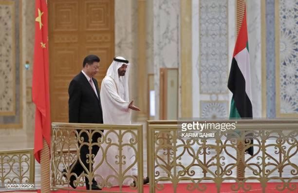 Chinese President Xi Jinping and Crown Prince of Abu Dhabi Sheikh Mohamed bin Zayed Al Nahyan arrive at the presidential palace in the UAE capital on...