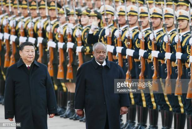 Chinese President Xi Jinping and Djibouti President Ismail Omar Guelleh attend a ceremony at the Great Hall of the People in Beijing on Nov 23 2017...