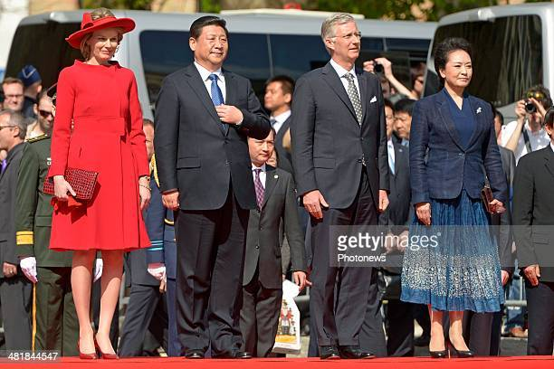Chinese President Xi Jinping and First Lady XiPeng Liyuan observe a departure ceremony with King Philippe and Queen Mathilde following an official...