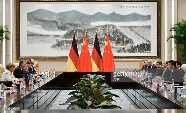 Chinese President Xi Jinping and German Chancellor Angela Merkel take part in a bilateral meeting the West Lake State House in Hangzhou on September...