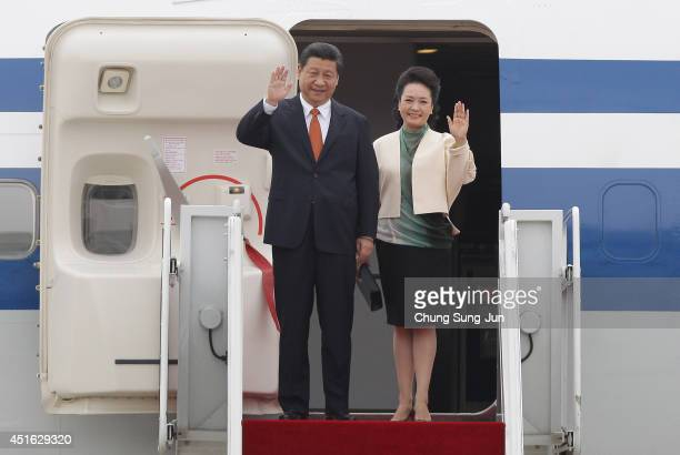 Chinese President Xi Jinping and his spouse Peng Liyuan arrive at Seoul military airport on July 3 2014 in Seoul South Korea President Xi Jinping is...