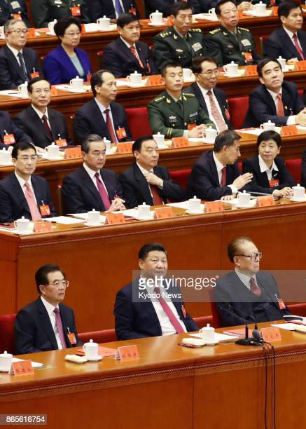 Chinese President Xi Jinping and his two immediate predecessors Hu Jintao and Jiang Zemin attend the closing ceremony of the Communist Party's...
