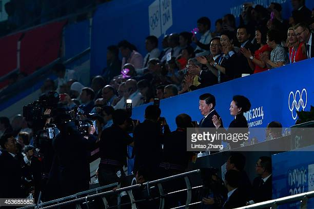 Chinese President Xi Jinping and his wife Peng liyuan attends the opening ceremony for the Nanjing 2014 Summer Youth Olympic Games at the Nanjing...