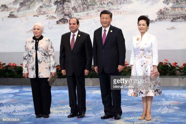 Chinese President Xi Jinping and his wife Peng Liyuan Egyptian President Abdel Fattah elSisi and his wife Entissar Amer pose for a photo prior to the...