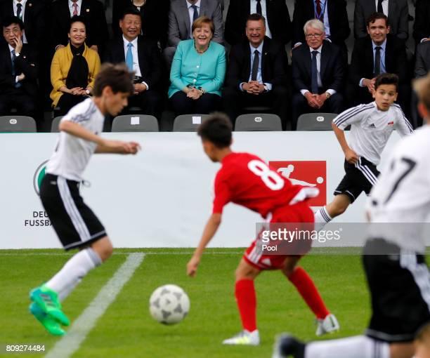 Chinese President Xi Jinping and his wife Peng Liyuan German Chancellor Angela Merkel Reinhard Grindel President of the German Football Association...