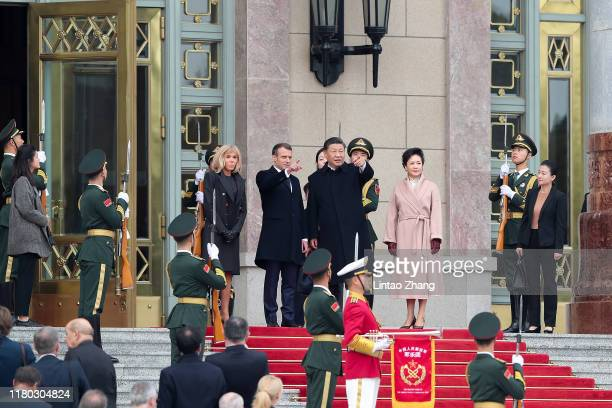 Chinese President Xi Jinping and his wife Peng Liyuan greet French President Emmanuel Macron and his wife First Lady Brigitte Macron during a...