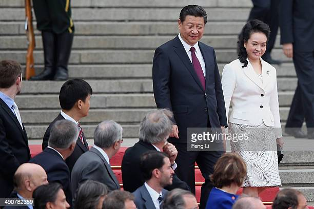 Chinese President Xi Jinping and his wife Peng liyuan wait for the arrival of Portuguese President Anibal Cavaco Silva during a welcome ceremony...