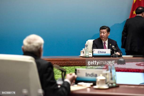 Chinese President Xi Jinping and Indian Prime Minister Narendra Modi attend the plenary session during the BRICS Summit at the Xiamen International...