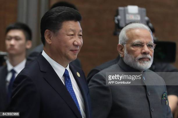 Chinese President Xi Jinping and Indian Prime Minister Narendra Modi attend the Dialogue of Emerging Market and Developing Countries on the sidelines...