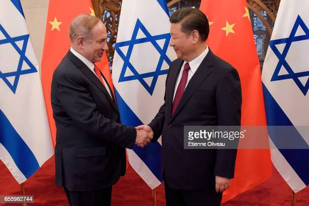 Chinese President Xi Jinping and Israeli Prime Minister Benjamin Netanyahu shake hands ahead of their talks at Diaoyutai State Guesthouse on March 21...