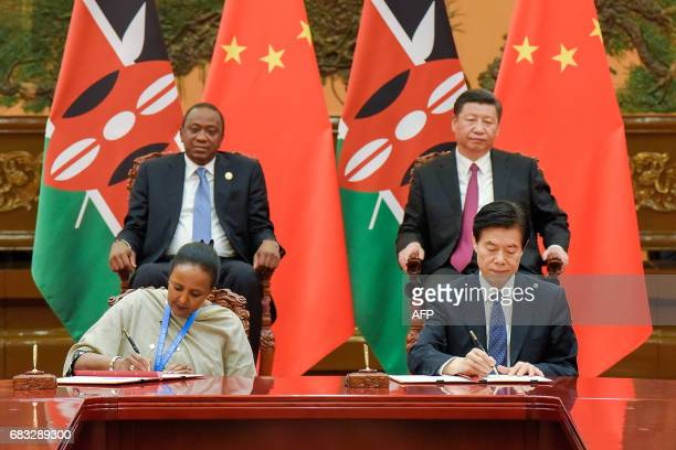 Chinese President Xi Jinping and Kenyan President Uhuru Kenyatta attend a signing ceremony after their bilateral meeting during the Belt and Road...