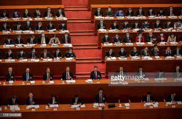 Chinese President Xi Jinping and members of the government gather during the opening session of the National People's Congress at the Great Hall of...