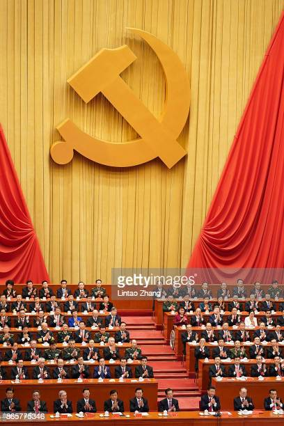Chinese President Xi Jinping and other Chinese politicians and delegates applauds duirng the closing of the 19th Communist Party Congress at the...