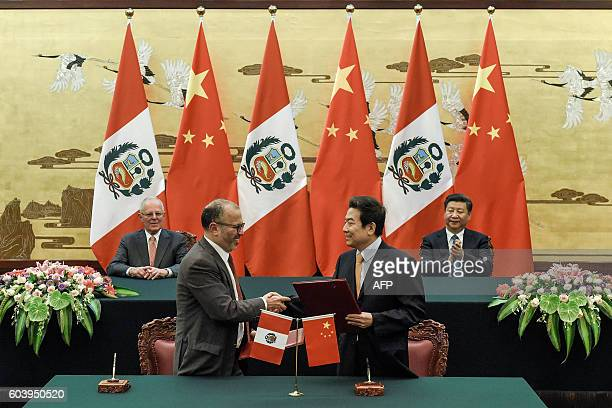 Chinese President Xi Jinping and Peruvian President Pedro Pablo Kuczynski attend a signing ceremony at the Great Hall of the People in Beijing on...