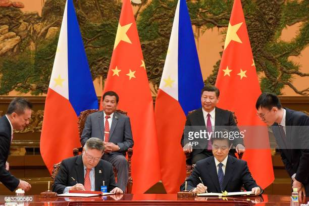 Chinese President Xi Jinping and Philippines President Rodrigo Duterte attend a signing ceremony after their bilateral meeting during the Belt and...