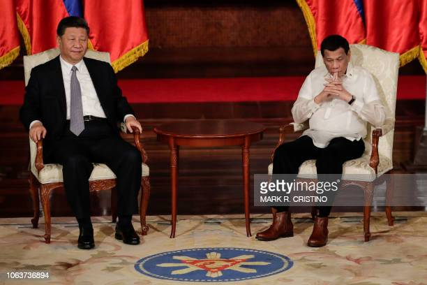 Chinese President Xi Jinping and Philippines' President Rodrigo Duterte during an exchange of agreements at the Malacanang Presidential Palace in...