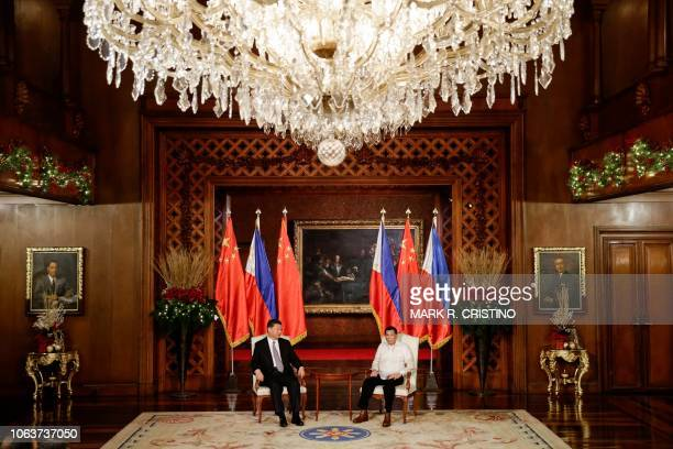 Chinese President Xi Jinping and Philippines' President Rodrigo Duterte look on during an exchange of agreements at the Malacanang Presidential...