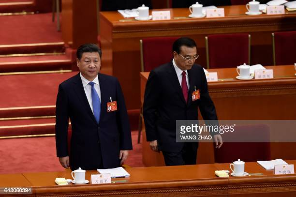 Chinese President Xi Jinping and Premier Li Keqiang arrive for the opening session of the National People's Congress China's legislature in Beijing's...