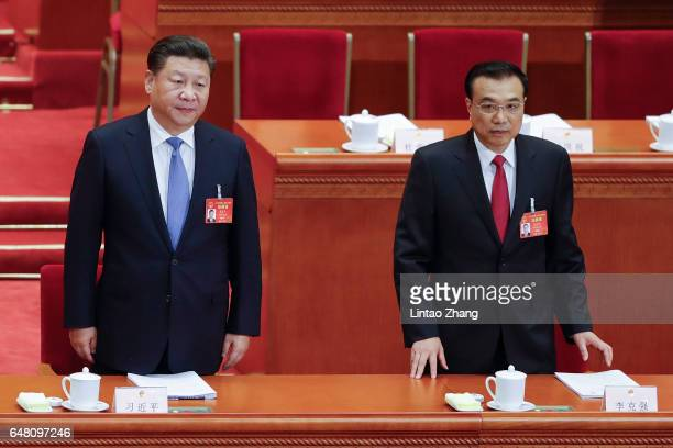 Chinese President Xi Jinping and Premier Li Keqiang arrive for the opening session of the National People's Congress at The Great Hall of People on...
