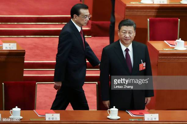 Chinese President Xi Jinping and Premier Li Keqiang arrive for the closing session of the National People's Congress at the Great Hall of the People...